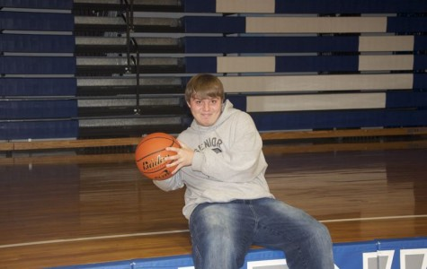 Student Manager Brings Charisma to Boys Basketball Team