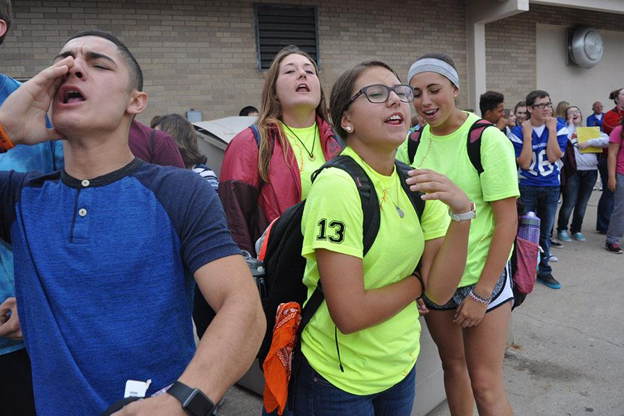 Seniors, from left to right, Rey Valdez, Sariah Grant, Peyton Stoike and Isabel Aguallo, join in on a cheer.