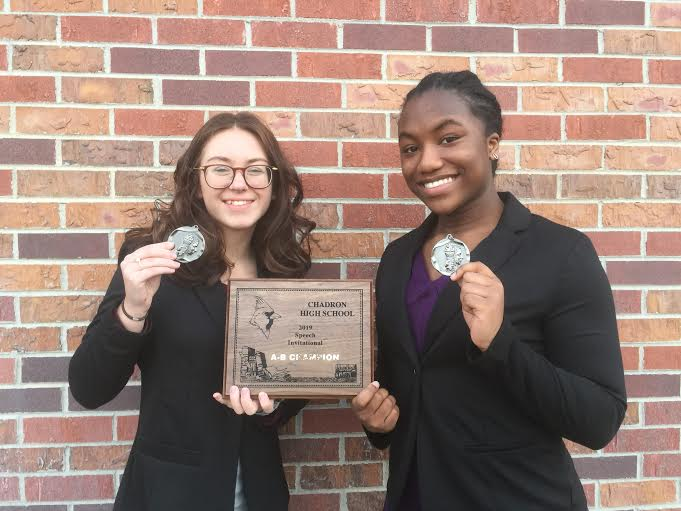 Laura Nieseler and Saphina Achi with their awards after a speech meet.